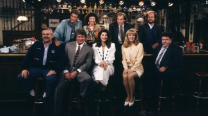 "CHEERS -- ""One for the Road"" Episode 25 -- Air Date 05/20/1993 -- Pictured: (Top, l-r) Ted Danson as Sam Malone, Rhea Perlman as Carla Tortelli, Woody Harrelson as Woody Boyd, Kelsey Grammer as Dr. Frasier Crane, (Front, l-r) John Ratzenberger as Cliff Clavin, Tom Berenger as Don Santry, Kirstie Alley as Rebecca Howe, Shelley Long as Diane Chambers, George Wendt as Norm Peterson -- Photo by: Paul Drinkwater/NBCU Photo Bank"