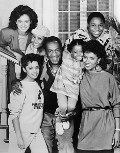 BLACK AND WHITE ONLY. SLUG: ST/SHALES4. CREDIT: Courtesy of NBC. CAPTION: NBC 75th ANNIVERSARY -- THE COSBY SHOW -- NBC Series -- Pictured: (clockwise from bottom left) Lisa Bonet as Denise Huxtable, Sabrina Le Beauf as Sondra Huxtable, Tempest Bledsoe as Vanessa Huxtable, Malcolm Jamal-Warner as Theodore Huxtable, Phylicia Rashad as Clair Huxtable, Keshia Knight Pulliam as Rudy Huxtable, Bill Cosby as Dr. Cliff Huxtable -- Broadcast Dates: (1986-1992)