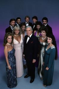 UNITED STATES - OCTOBER 04: DYNASTY - cast gallery - Season Four - 10/4/83, Pictured, back row, left: John James (Jeff), Michael Nader (Dexter), Al Corley (Steven), Gordon Thomson (Adam), Geoffrey Scott (Mark); middle row: Pamela Sue Martin (Fallon), Deborah Adair (Tracy); bottom row: Pamela Bellwood (Claudia), Linda Evans (Krystle), John Forsythe (Blake), Joan Collins (Alexis), Kathleen Beller (Kirby), (Photo by ABC Photo Archives/ABC via Getty Images)